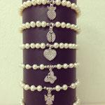Bracciali con perle elastici e soggetti zirconati