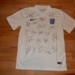Signed by the whole team - Gerrard, Hart, Johnson, Sturridge, Rooney etc.