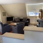 Wohnbereich mit dänischem Ofen u. Aufbettungsmöglichkeit für weitere Gäste