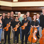 The musicians and the luthiers pose for a group shot after the concert.