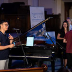 Pianist Philip Chiu speaks at Friday Night Mainstage concert prior to performance.