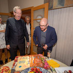Festival co-founders Keith Medley and Mark Fewer blow out the candles on the annivesary cake.