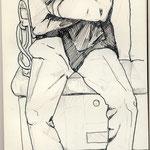 Mann in U-Bahn schlafend