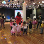 An impromptu disco at the Clore Ballroom. Madame Lark dances with some of the children - IMAGINE Children's Festival 2014 London