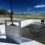 Un bassin de rétention des eaux de pluie pour diminuer l'apport d'eau au cours d'eau en cas de fortes pluies
