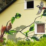 Wandmalerei auf einer privaten Hausfassade