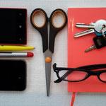 deze spullen zitten allemaal in het voorbeeld tasje op de eerste foto.