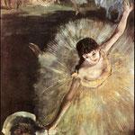 Bailarina con ramo de flores en escenario_