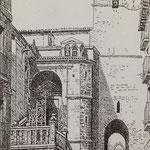 """1888 Calle del Puente desde el norte. A la izquierda, acceso a la Catedral por la """"Escalera de los Mártires"""". A la derecha, entrada hacia Ruamayor por debajo de la torre de la Catedral"""