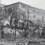 1941 Conjunto de la Catedral desde la Calle Cádiz. A la izquierda, ruinas del Palacio Episcopal, construido a comienzos del siglo XX sobre los restos del Hospital del Santo Espíritu (siglo XIV); a la derecha, fachada sur del claustro