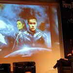 Auf der Leinwand werden die verschiedenen Phasen des Titelbildes 3000 gezeigt
