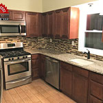 Grainte Countertops, Medium Recessed Panel Cabinetry, Stainless Stell Apliances, Drop In Sink and Ceramic Tile Flooring