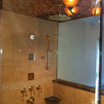 Master Suite Walk In Glass Enclosed Shower with Body Jets and Rain Head