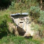 Fertiger Bunker mit neu gemauertem Eingangsbereich und neuer Tür