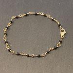 """127) Armband """"Cosmos"""" mit Gelbgold 750 mit schwarzen Diamanten, 480.-"""