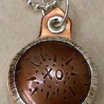 XO locket.