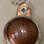 XO locket.
