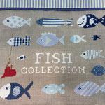 Particolare cuscino con ricamo pesci