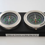 Prière de Toucher on mute map for D., 2015, two compass on wooden support and aluminium plate
