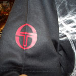 Taccini T-Polo 袖のロゴ