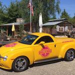 Beschriftung eines Firmenfahrzeuges der Würzburger Grillschule, Fahrzeugbeschriftung, Werbetechnik