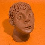 Une tête en argile