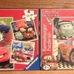 € 5,00 voor deze twee dozen Ravensburger 20x20stukjes en 3x49stukjes Cars puzzels