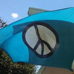 A peace flag flutters on Venice Avenue.
