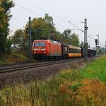 145 031 mit Straßenbahnüberführung am BÜ Colmnitz
