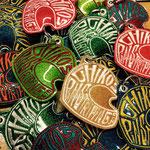 Kool custom made key fobs for Chikos Pinstriping. embroidery on glitter vinyl.