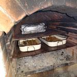 Schweinebraten und Kartoffelwurst auf unserem Grill