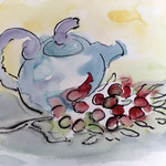 Teekanne und Früchte