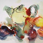 Teekanne mit Früchten