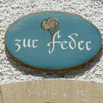 Türschild «Haus zur Feder»