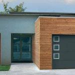 porte de garage sectionnelle avec inserts inox