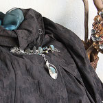 Sophisticated jacket serves as a backtrop for teal toned labradorite