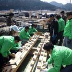 東北遊技機商協同組合商社部会(緑のジャケット)