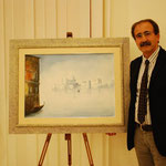 Luigi Caputo (pittore)a fianco una sua opera