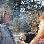 Student Erin practices smudging on classmate Linda