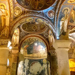 dark church in Göreme is a cave in the tuff rocks as well