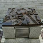 Steuerungsbox mit Granithülle und Bronzerelief