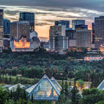 View of downtown highrise buildings and the Muttart Conservatory pyramids in the Edmonton River Valley © Neil Zeller @neil_zee