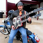 "Robert Rodriguez with 'Yepes Signature' Gibson Custom ""Shotgun Messenger"" Double-Neck Guitar • Robert Rodriguez Collection; at Troublemaker Studios, Austin, Texas  USA"