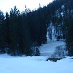 Zugefrohrener See.