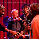"""TC Tolliver (drums) offers a present to Heinrich """"the checker"""" Prokopetz, who is gently introduced by Martin Kafka (in the center, as usual...)"""