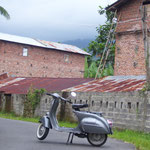 ...Vespa near a tobacco-drying-oven...