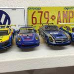 Robies Zent Porsche neben einem der drei Serengeti SLS (hier von Heinrich). Rechts der Audi R8 von Mario.