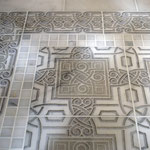 "Why must floors be boring? A decorative ""rug"" design in the entryway or bathroom creates a rich experience."