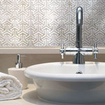 A clean geometric pattern tile creates the look of delicate latticework with smooth refinement.
