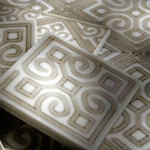 The patterned mural tiles come individually so you can integrate them into your design as you see fit.